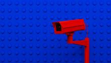 Red Surveillance Camera On Blu...