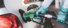 Woman Filling Up Petrol Into H...