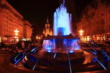 Illuminated Fountain Against T...
