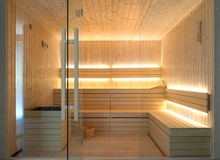 Front View Of Empty Finnish Sauna Room. Modern Interior Of Wooden Spa Cabin With Dry Steam