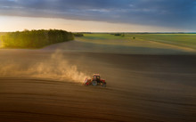 Tractor Sowing Soil In Spring