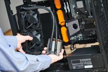 Computer Assembling Service. Serviceman Installing Liquid Cooling System On Processor