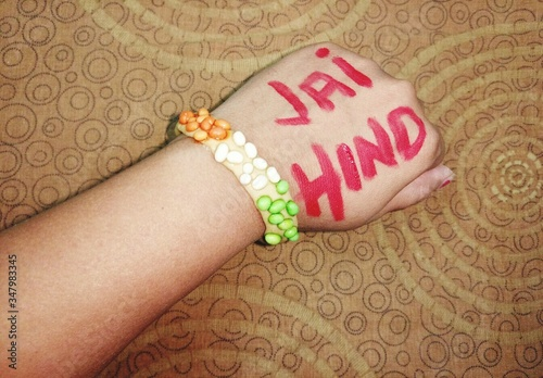 Canvas Print Cropped Hand Of Woman With Jai Hind Text Against Wall