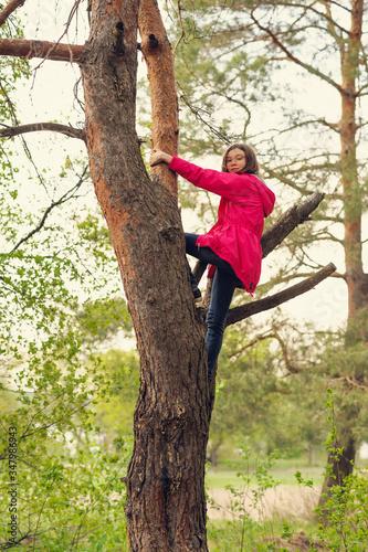 brave girl climbs high on a tree Canvas Print