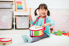 Toddler Girl Play Drum At Home For Homeschooling