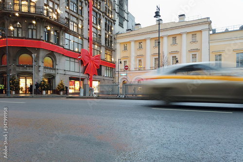 Moscow at day the taxi car passing by Wallpaper Mural