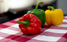 Three Colored Bell Peppers Pla...