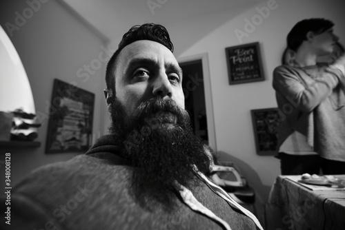 Fotografia Bearded Man Sitting At Home