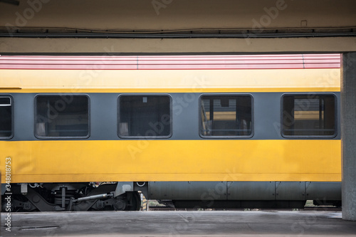 Passenger car abiding by European standards on standby, empty, in a typical platform of a train station in Europe Wallpaper Mural