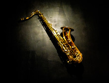 High Angle View Of Saxophone On Black Background