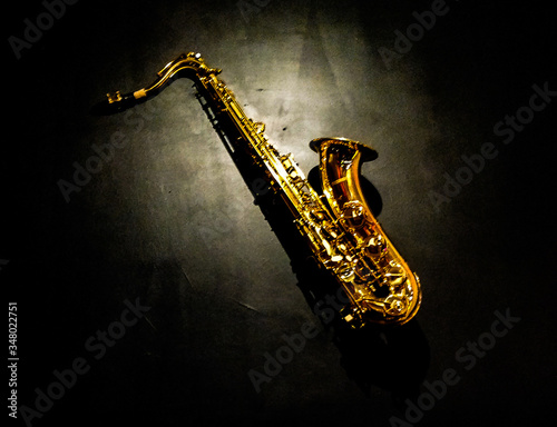 High Angle View Of Saxophone On Black Background Fototapeta