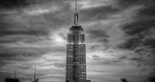 Empire State Building Against Cloudy Sky At Dusk