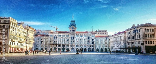 Fotografering Panoramic View Of Piazza Unita Ditalia Against Blue Sky On Sunny Day