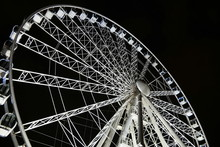 Low Angle View Of Ferris Wheel Against Sky At Night