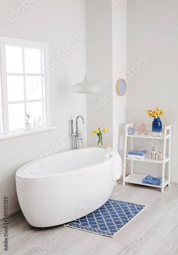 Interior of bathroom with fresh flowers