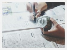View Of Person Holding Jar And Drawing In Newspaper