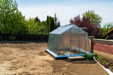 Greenhouse In The Garden With ...