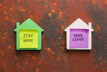 Models Of Houses With Text STAY HOME, SAVE LIVES On Color Background