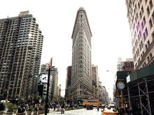 Low Angle View Of Flatiron Building And Towers At Manhattan