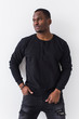 Youth street fashion concept - Portrait of confident sexy black man in stylish sweatshirt on white background.