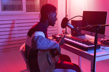 African American Professional Musician Recording Guitar In Digital Studio At Home, Music Production Technology Concept.