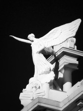 Low Angle View Of Angel Statue At Night