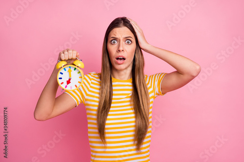Fototapeta Close-up portrait of her she nice attractive lovely discontent worried girl holding in hands retro clock overtime loss omg isolated over pink pastel color background obraz
