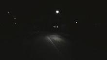 Illuminated Street Light On Roadside In City