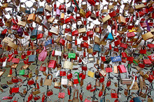 Large Group Of Padlocks On Chain Link Fence