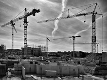 View Of Cranes At Construction Site Against Sky