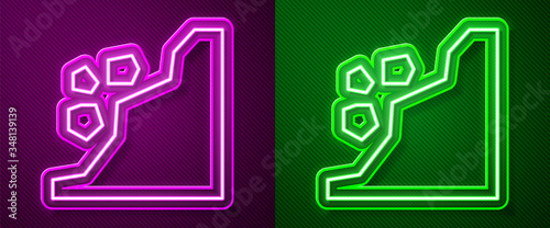 Fotografie, Obraz Glowing neon line Landslide icon isolated on purple and green background