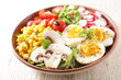 Leinwandbild Motiv buddha bowl- vegetable salad with corn, tomato, radish and egg
