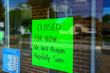 Closed Sign On Glass Window