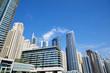 Dubai Marina skyscrapers low angle view in a sunny day, clear blue sky in Dubai