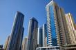 Dubai Marina skyscrapers in a sunny day, clear blue sky in Dubai