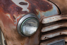 Old Car Headlight In A Fender