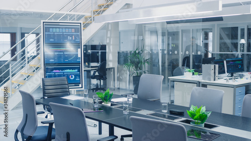 Fototapeta Shot of Empty Conference Room with Table to Discuss Business Opportunities and Interactive Digital Whiteboard in Vertical Mode Showing Company Growth Strategy. obraz
