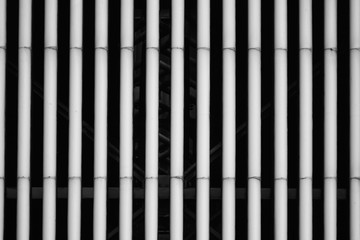 Abstract detailed view of the plastic pipes of an industrial cooling unit, as pattern, background or texture