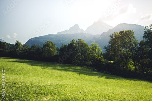 Scenic view of green meadow and high mountains. Location place Berchtesgaden land, Germany alp. #348220711
