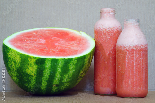 Glass bottles filled with freshly blended watermelon juice Wallpaper Mural