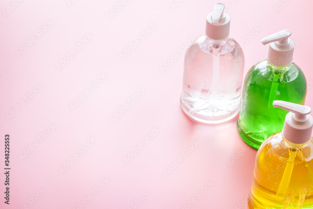 Fototapeta Sanitazer and soap for hands - infection disease prevention - on pink table space for text