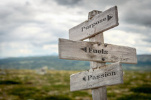 Purpose Fuels Passion Text Engraved On Old Wooden Signpost Outdoors In Nature. Quotes, Words And Illustration Concept.