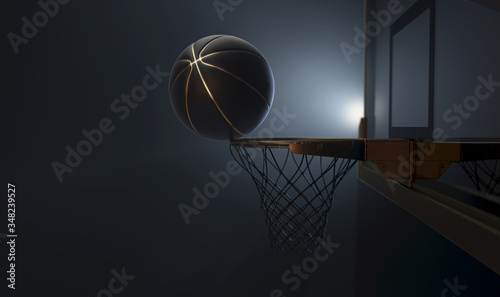 Vászonkép An action shot of a black and gold basketball teetering on the rim of a regular