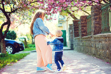 Playful Child And Young Mother Enjoy Springtime. Spring Lifestyle.