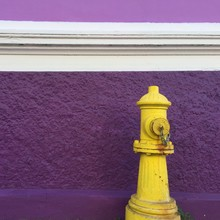 Close-up Of Fire Hydrant Against Purple Wall