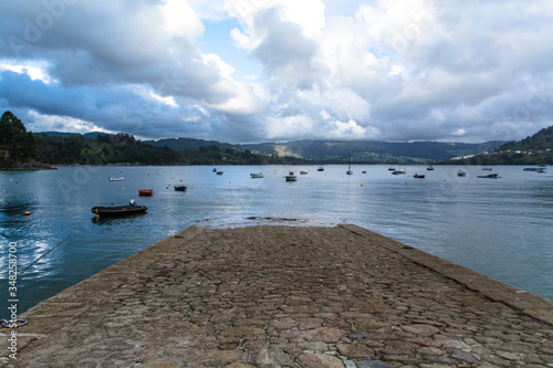Boat Ramp On Sea Against Cloudy Sky Canvas