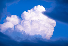 White And Blue Cumulus Fluffy Sunset Cloud In The Sky