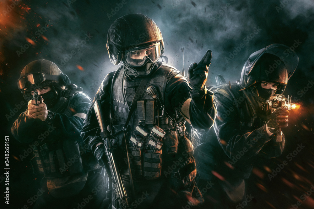 Fototapeta Three soldiers in full uniform with guns is going to attack. Uniform conforms to special services FSB (soldiers) of the Russian Federation. Shot in studio. Explosion on a black background