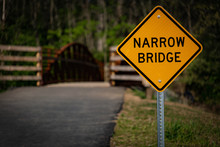 Narrow Bridge Sign In The Park...