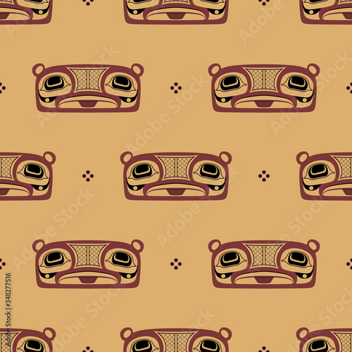 Seamless ethnic pattern with Native American Tlingit masks of totem bear.